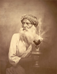 Portrait of a bearded man with a lamp, Eastern Bengal.